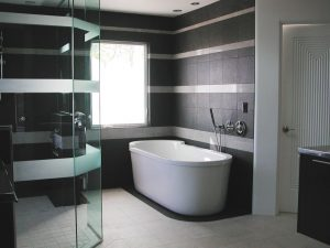 Contact SHEAR for assistance with glass doors, windows and other glass products like the shower screen or window in this bathroom. Bathroom with Frameless glass shower screen