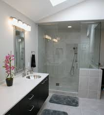 SHEAR's range of other glass and aluminium products include Frameless Glass Shower Screens and mirrors similar to those pictured in this modern bathroom